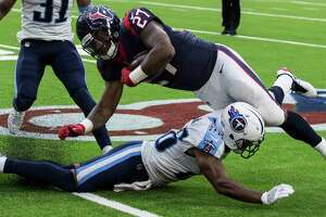 Houston Texans running back D'Onta Foreman (27) is tripped up by Tennessee Titans cornerback Logan Ryan (26) during the fourth quarter of an NFL football game at NRG Stadium on Sunday, Oct. 1, 2017, in Houston.