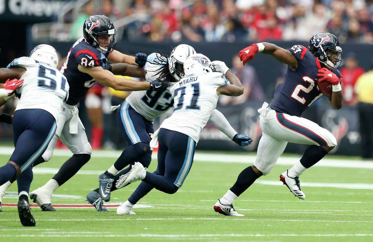 Houston Texans running back D'Onta Foreman (27) breaks out of the pack during the fourth quarter of an NFL football game at NRG Stadium, Sunday, Oct. 1, 2017, in Houston.