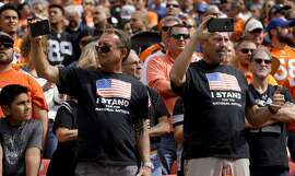 Fans stand during the national anthem before an NFL football game between the Denver Broncos and the Oakland Raiders, Sunday, Oct. 1, 2017, in Denver. (AP Photo/Joe Mahoney)