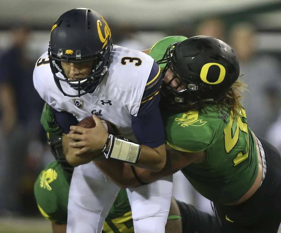 California quarterback Ross Bowers, left, is sacked by Oregon's Henry Mondeaux during the third quarter of an NCAA college football game Saturday, Sept. 30, 2017, in Eugene, Ore. (AP Photo/Chris Pietsch) Photo: Chris Pietsch, Associated Press