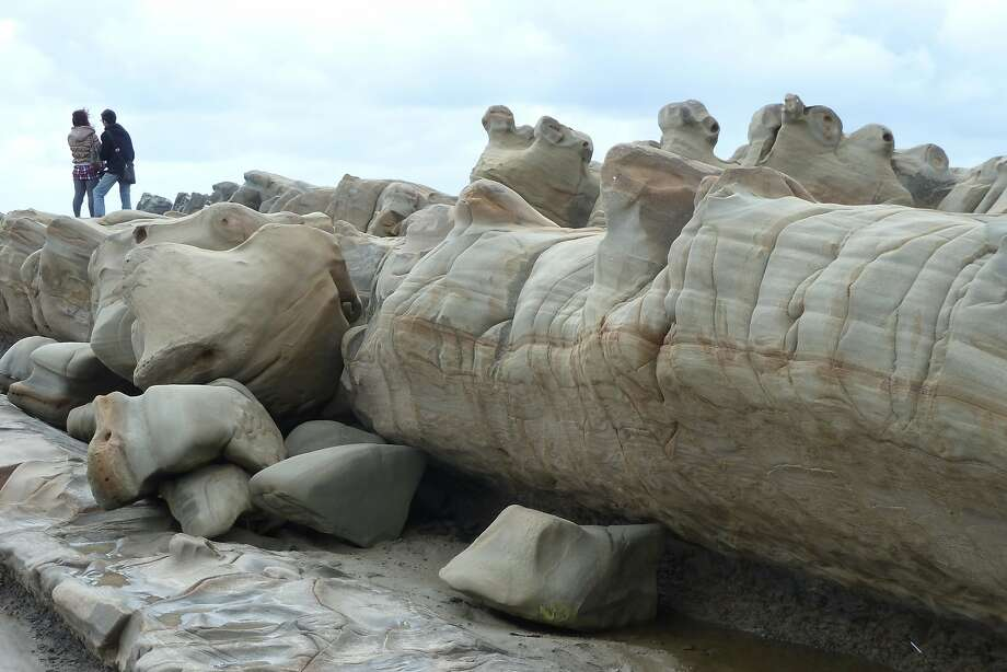 Visitors walk around the bizarre rock formations in the Xiaoyeliu area of the east coast of Taiwan. Photo: Spud Hilton, The Chronicle