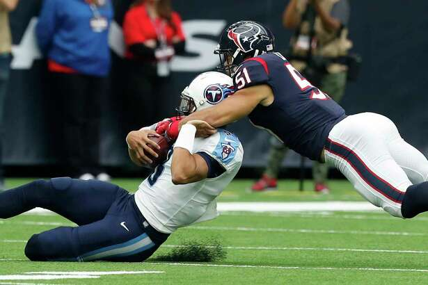 Houston Texans linebacker Dylan Cole (51) tackles Tennessee Titans quarterback Marcus Mariota (8) during the first quarter of an NFL football game at NRG Stadium on Sunday, Oct. 1, 2017, in Houston.