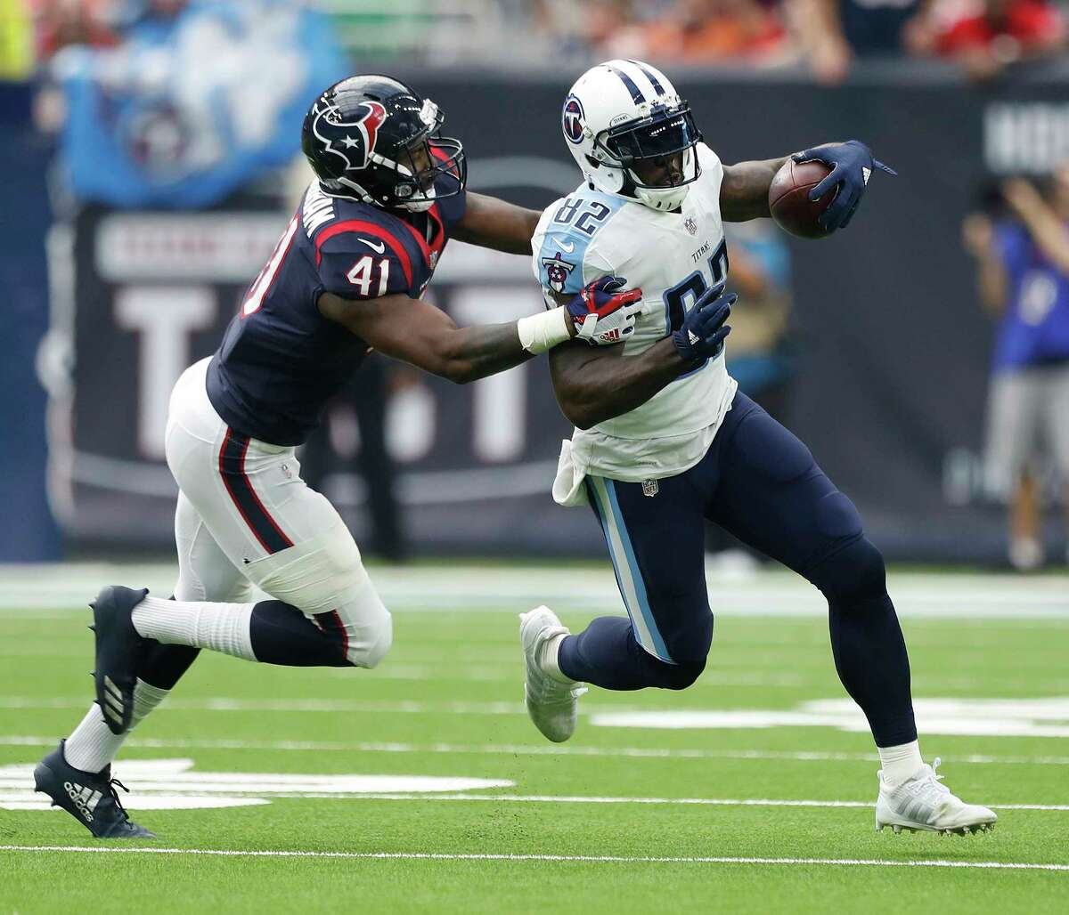 Tennessee Titans tight end Delanie Walker (82) runs the ball against Houston Texans inside linebacker Zach Cunningham (41) during the second quarter of an NFL football game at NRG Stadium, Sunday, Oct. 1, 2017, in Houston.