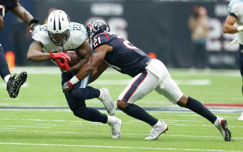 Tennessee Titans running back Derrick Henry (22) gets stopped by Houston Texans defensive back Marcus Gilchrist (21) during the second quarter of an NFL football game at NRG Stadium, Sunday, Oct. 1, 2017, in Houston. Photo: Karen Warren, Houston Chronicle / @ 2017 Houston Chronicle