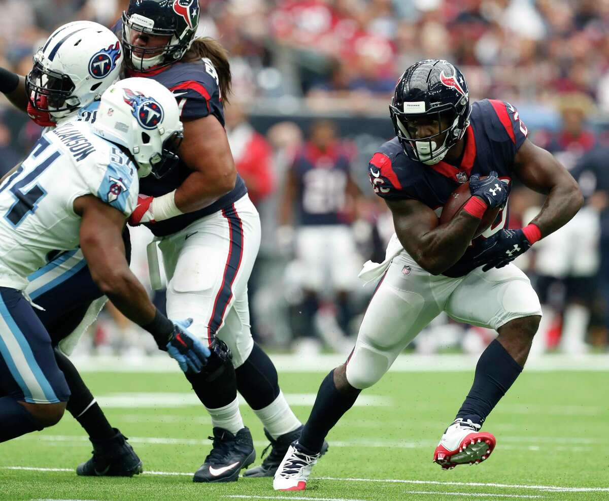 Houston Texans running back Lamar Miller (26) cuts outside against Tennessee Titans inside linebacker Avery Williamson (54) during the second quarter of an NFL football game at NRG Stadium on Sunday, Oct. 1, 2017, in Houston.