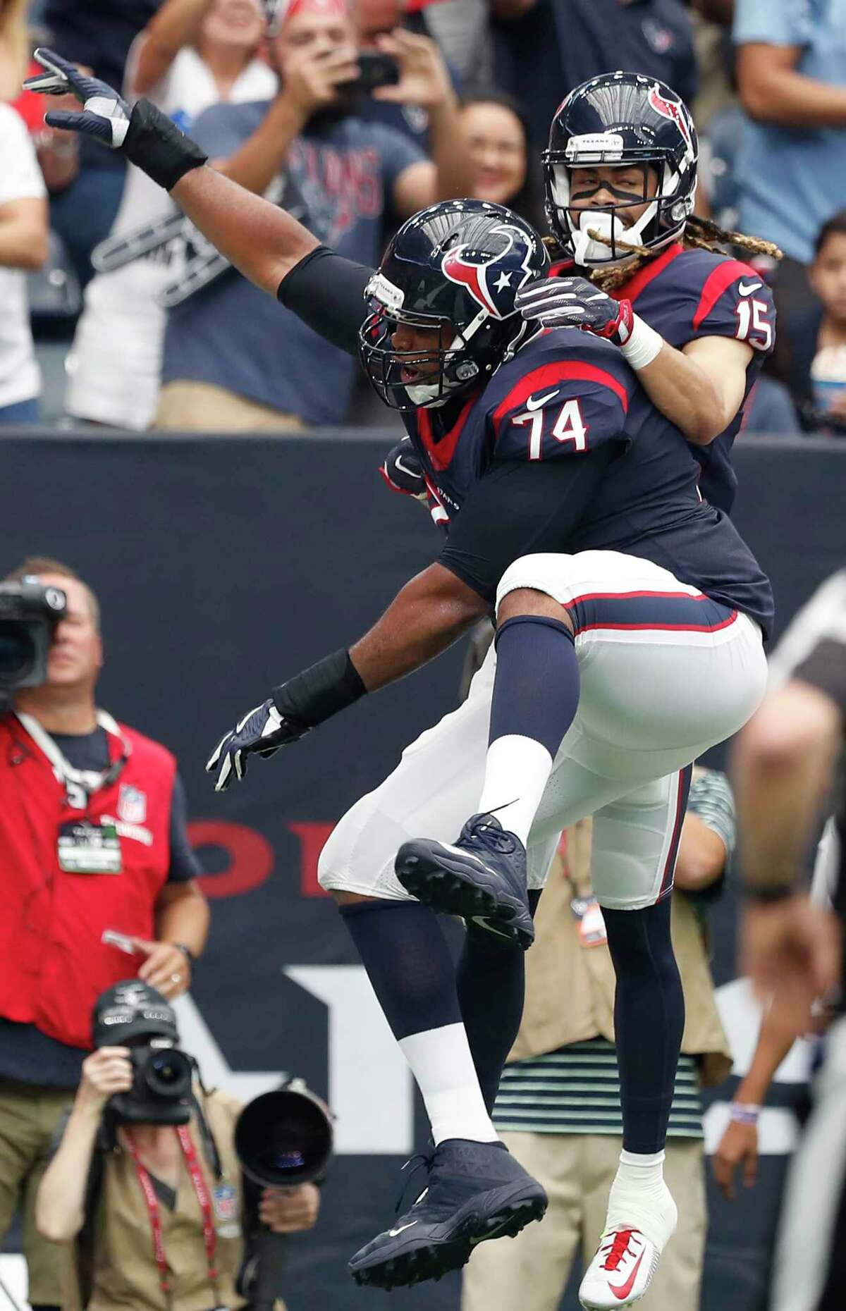 Houston Texans wide receiver Will Fuller (15) and tackle Chris Clark (74) celebrate Fuller's 16-yard touchdown reception against the Tennessee Titans during the second quarter of an NFL football game at NRG Stadium on Sunday, Oct. 1, 2017, in Houston.