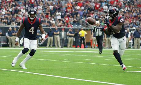 Houston Texans running back Lamar Miller (26) catches a pass from quarterback Deshaun Watson (4) on his way into the end zone for a touchdown during the first quarter of an NFL football game at NRG Stadium, Sunday, Oct. 1, 2017, in Houston.