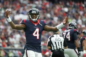 Houston Texans quarterback Deshaun Watson (4) celebrates after DeAndre Hopkins' touchdown during the first quarter of an NFL football game at NRG Stadium, Sunday, Oct. 1, 2017, in Houston.