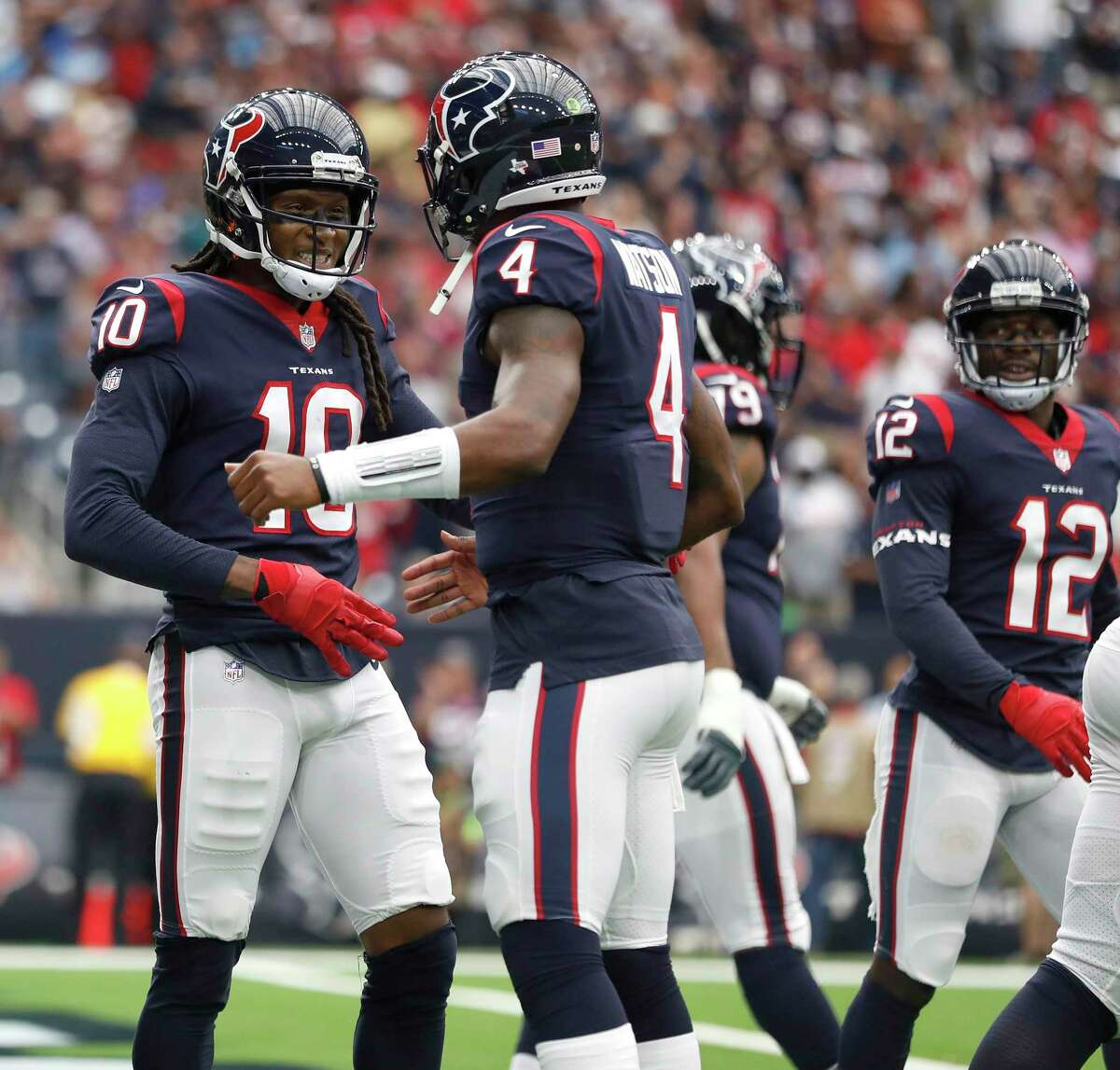 Houston Texans wide receiver DeAndre Hopkins (10) celebrates his touchdown with quarterback Deshaun Watson (4) during the first quarter of an NFL football game at NRG Stadium, Sunday, Oct. 1, 2017, in Houston.