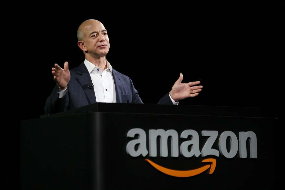 FILE - Jeff Bezos unveils new Kindle reading devices at a press conference in Santa Monica. Photo: David McNew