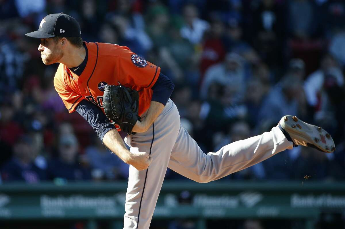 Houston Astros' Collin McHugh pitches during the first inning of a baseball game against the Boston Red Sox in Boston, Sunday, Oct. 1, 2017. (AP Photo/Michael Dwyer)