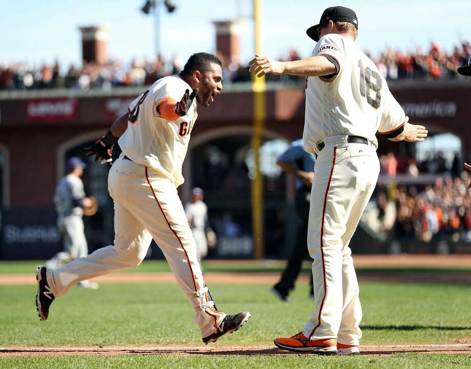 San Francisco Giants' Pablo Sandoval is greeted by Matt Cain after his walk off home run in 9th inning of Giants' 5-4 win over San Diego Padres in MLB game at AT&T Park in San Francisco, Calif., on Sunday, October 1, 2017. Photo: Scott Strazzante / The Chronicle