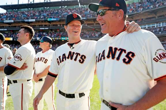 San Francisco Giants' Matt Cain shares  laugh with pitching coach, Dave Righetti, before Cain honored for his 13 years with the team after Giants' 5-4 win over San Diego Padres in MLB game at AT&T Park in San Francisco, Calif., on Sunday, October 1, 2017.