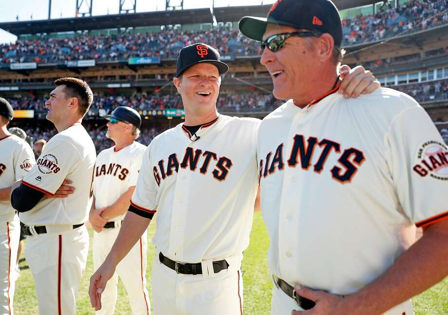 San Francisco Giants' Matt Cain shares  laugh with pitching coach, Dave Righetti, before Cain honored for his 13 years with the team after Giants' 5-4 win over San Diego Padres in MLB game at AT&T Park in San Francisco, Calif., on Sunday, October 1, 2017. Photo: Scott Strazzante / The Chronicle