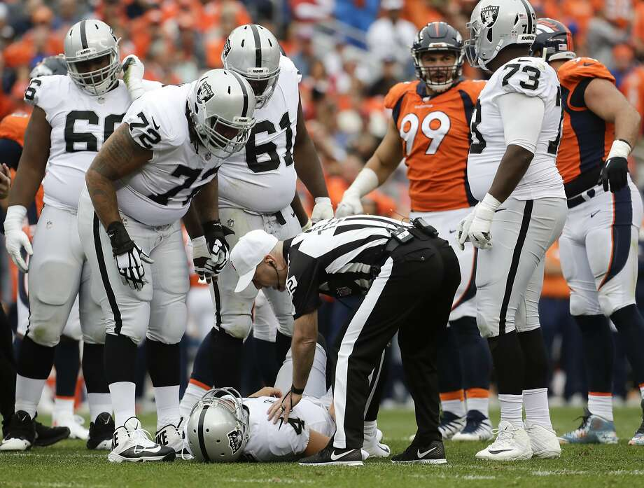 Oakland Raiders quarterback Derek Carr lays the field after being injured during the second half of an NFL football game against the Denver Broncos Sunday, Oct. 1, 2017, in Denver. (AP Photo/Joe Mahoney) Photo: Joe Mahoney, Associated Press