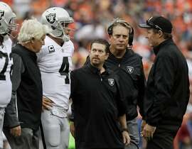 Oakland Raiders quarterback Derek Carr is helped off the field after being injured during the second half of an NFL football game against the Denver Broncos Sunday, Oct. 1, 2017, in Denver. (AP Photo/Joe Mahoney)