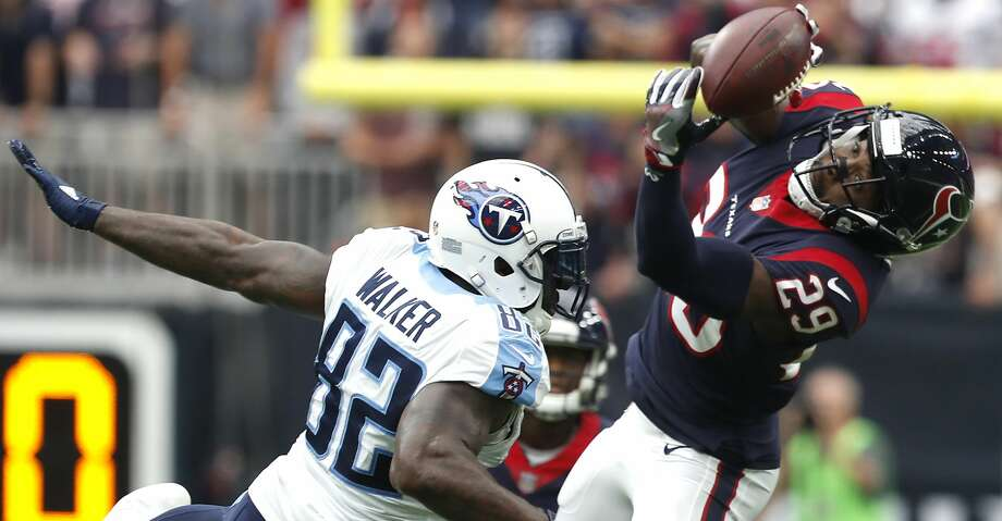 PHOTOS: Texans 57, Titans 14Houston Texans free safety Andre Hal (29) intercepts a pass intended for Tennessee Titans tight end Delanie Walker (82) during the first quarter of an NFL football game at NRG Stadium on Sunday, Oct. 1, 2017, in Houston. ( Brett Coomer / Houston Chronicle )Browse through the photos to see action from the Texans' win over the Titans on Sunday. Photo: Brett Coomer/Houston Chronicle