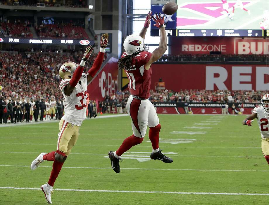 Arizona Cardinals wide receiver Larry Fitzgerald (11) pulls in the game winning touchdown as San Francisco 49ers cornerback Rashard Robinson (33) defends during overtime of an NFL football game, Sunday, Oct. 1, 2017, in Glendale, Ariz. The Cardinals won 18-15. (AP Photo/Rick Scuteri) Photo: Rick Scuteri, Associated Press