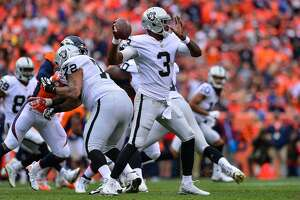 DENVER, CO - OCTOBER 1:  Quarterback EJ Manuel #3 of the Oakland Raiders passes against the Denver Broncos in the third quarter of a game at Sports Authority Field at Mile High on October 1, 2017 in Denver, Colorado. (Photo by Dustin Bradford/Getty Images)