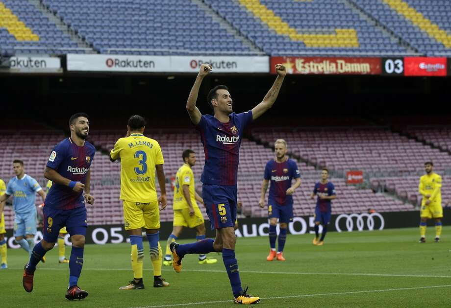 Barcelona's Sergio Busquets is celebrates his goal during the Spanish La Liga soccer match between Barcelona and Las Palmas at the Camp Nou stadium in Barcelona, Spain, Sunday, Oct. 1, 2017. Barcelona's Spanish league game against Las Palmas is played without fans amid the controversial referendum on Catalonia's independence. (AP Photo/Manu Fernandez) Photo: Manu Fernandez, Associated Press