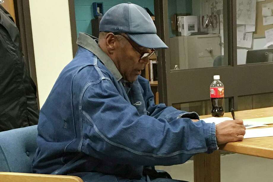 Former football legend O.J. Simpson signs documents at the Lovelock Correctional Center, Saturday, Sept. 30, 2017, in Lovelock, Nev. Simpson was released from the Lovelock Correctional Center in northern Nevada early Sunday, Oct. 1, 2017. (Brooke Keast/Nevada Department of Corrections via AP) Photo: Brooke Keast, HOGP / Copyright 2017 The Associated Press. All rights reserved.