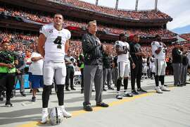 DENVER, CO - OCTOBER 1:  Oakland Raiders personnel, including Derek Carr #4 and head coach Jack Del Rio, stand during the national anthem before a game against the Denver Broncos at Sports Authority Field at Mile High on October 1, 2017 in Denver, Colorado. (Photo by Matthew Stockman/Getty Images)