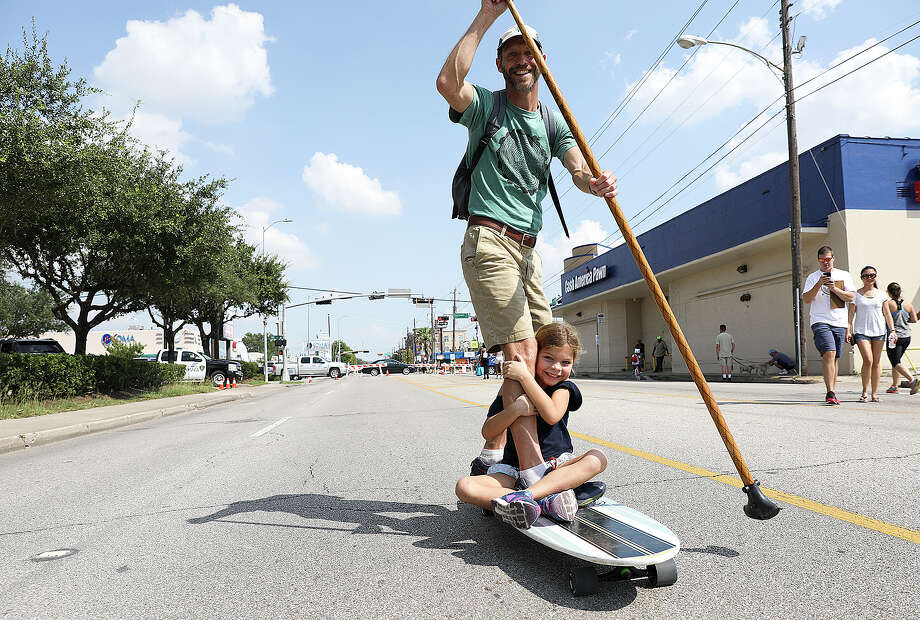 Ella Moore, 7, holds onto her dad Brad's leg as they make their way down Washington Ave., during Cigna's City Streets, the city's first major civic event since Hurricane Harvey, on Sunday. The event  closed down Washington Ave., between Heights and Westcott for pedestrian traffic only. Photo: Elizabeth Conley, Houston Chronicle / © 2017 Houston Chronicle