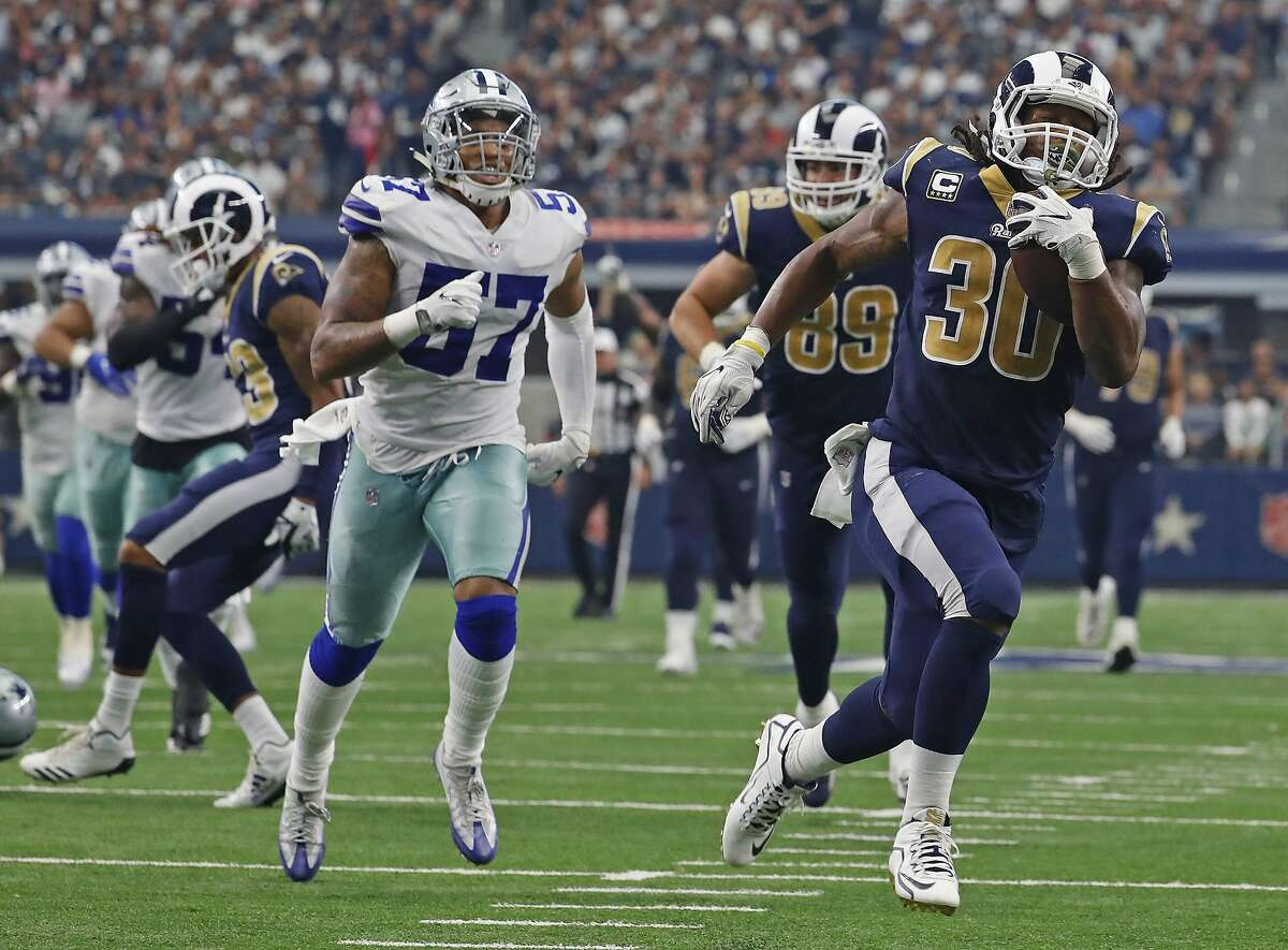 Rams running back Todd Gurley (30) leaves the Dallas Cowboys defense behind as he runs for a third quarter touchdown.