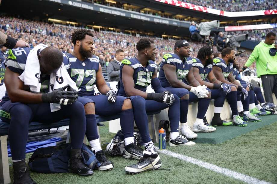 Seahawks players sit during the playing of the national anthem before Seattle's game versus the Indianapolis Colts at CenturyLink Field on Sunday, Oct. 1, 2017. Photo: Grant Hindsley/SeattlePI