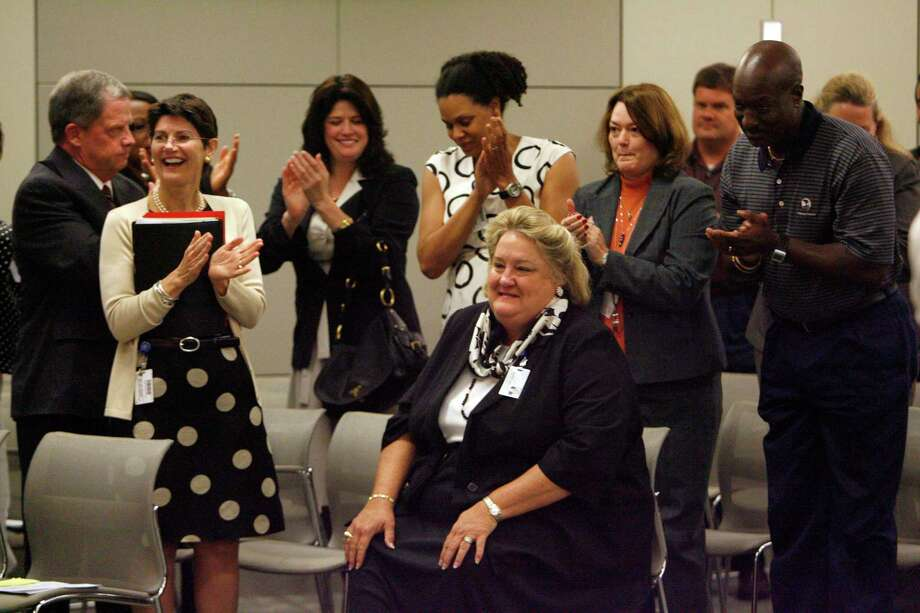 Surrounded by supporters Melinda Garrett, (center) is applauded as she was announced as the HISD interim CFO at the Hattie Mae White Educational Support Center during an HISD board meeting Thursday, Aug. 20, 2009, in Houston.  ( Johnny Hanson / Chronicle ) Photo: Johnny Hanson, Staff / Houston Chronicle