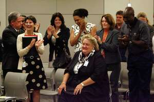Surrounded by supporters Melinda Garrett, (center) is applauded as she was announced as the HISD interim CFO at the Hattie Mae White Educational Support Center during an HISD board meeting Thursday, Aug. 20, 2009, in Houston.  ( Johnny Hanson / Chronicle )