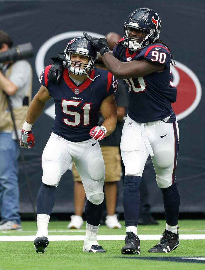 The Texans' Dylan Cole (51) celebrates his fourth-quarter  touchdown off a 25-yard interception return with fellow linebacker Jadeveon Clowney. Photo: Karen Warren, Staff / @ 2017 Houston Chronicle