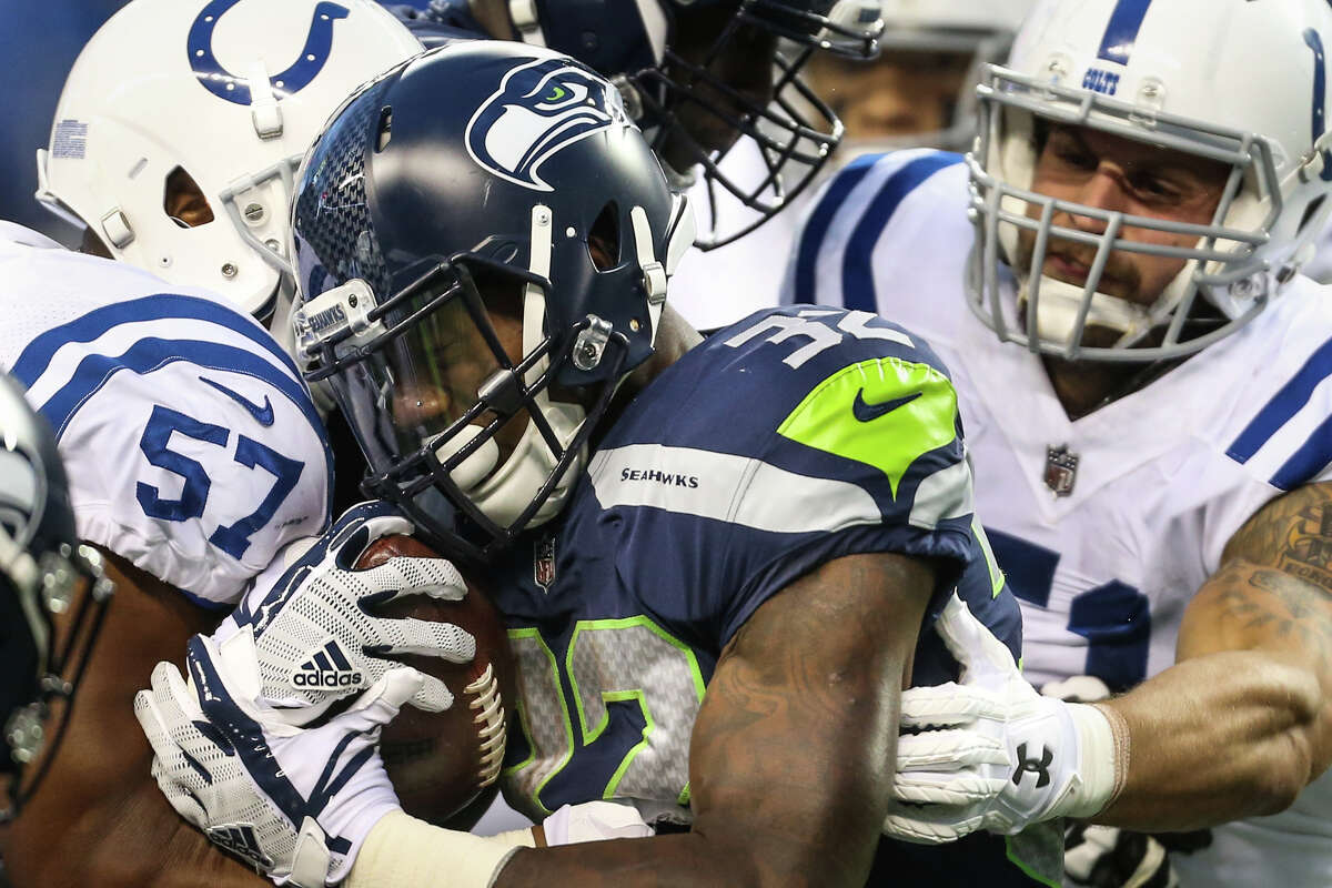 Seahawks running back Chris Carson is hit by Colts linebacker Jon Bostic during the first half at CenturyLink Field on Saturday, Oct. 1, 2017.