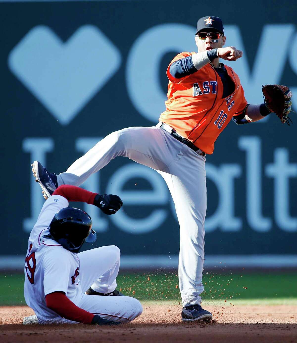 Boston Red Sox's Jackie Bradley Jr. (19) is forced out at second base as Houston Astros' Yuli Gurriel (10) turns the double play on Sam Travis during the fourth inning of a baseball game in Boston, Sunday, Oct. 1, 2017. (AP Photo/Michael Dwyer) ORG XMIT: MAMD106