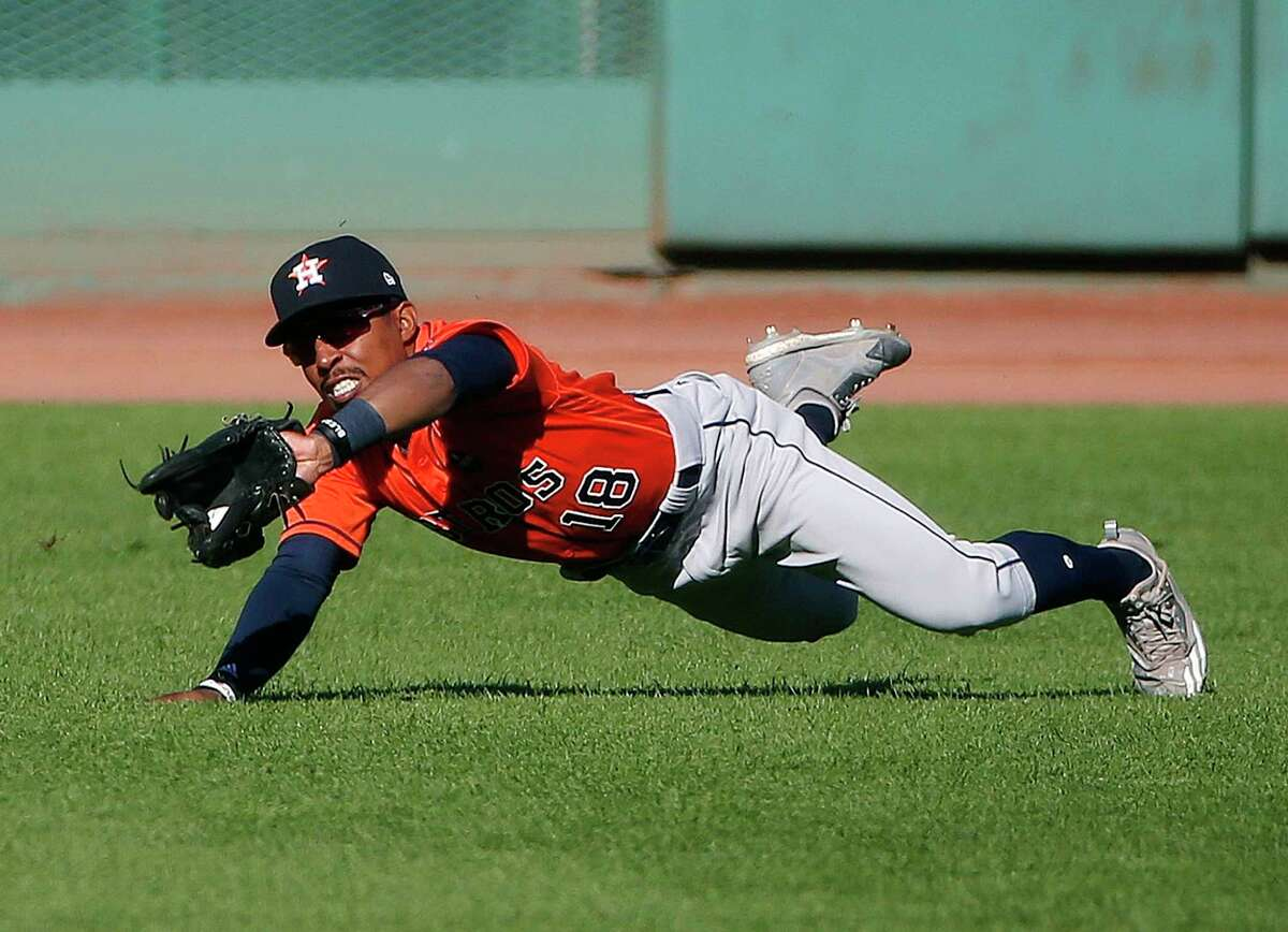 Houston Astros' Tony Kemp makes the catch on the fly out by Boston Red Sox's Sam Travis during the second inning of a baseball game in Boston, Sunday, Oct. 1, 2017. (AP Photo/Michael Dwyer) ORG XMIT: MAMD103