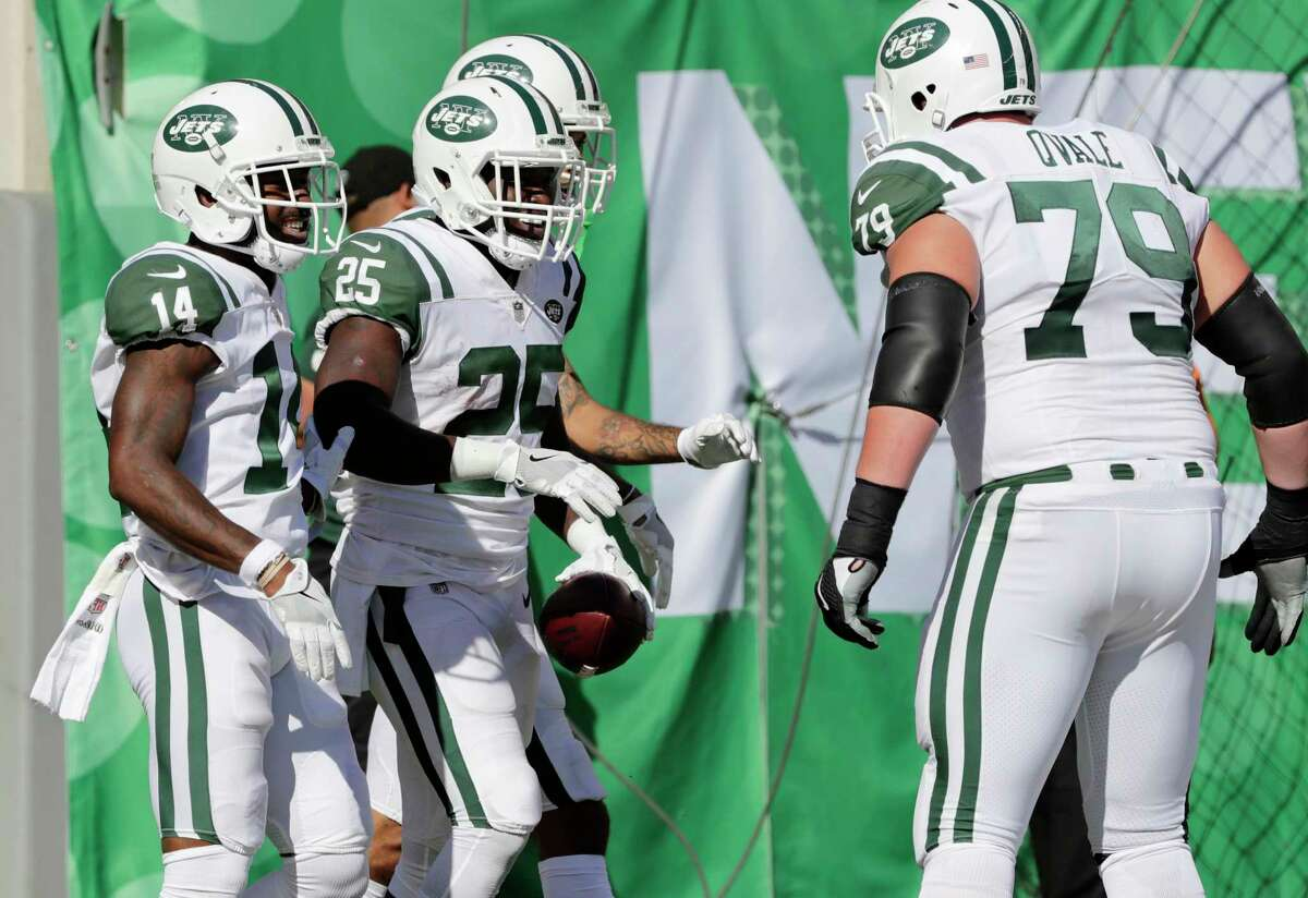 New York Jets Elijah McGuire, second from left, celebrates his touchdown during the second half of an NFL football game against the Jacksonville Jaguars, Sunday, Oct. 1, 2017, in East Rutherford, N.J. (AP Photo/Frank Franklin II) ORG XMIT: NJSW116