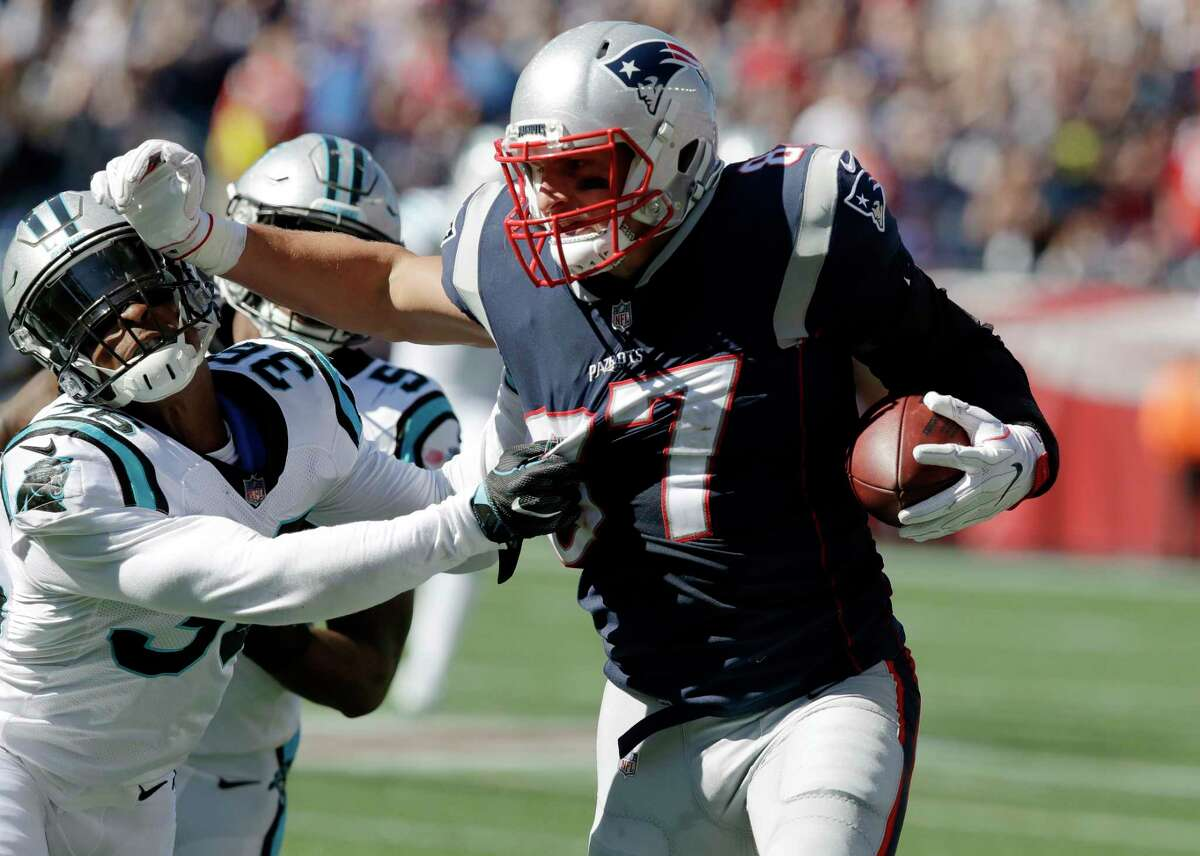 New England Patriots tight end Rob Gronkowski (87) tries to shove away Carolina Panthers defensive back Demetrious Cox (36) after catching a pass during the first half of an NFL football game, Sunday, Oct. 1, 2017, in Foxborough, Mass. (AP Photo/Charles Krupa) ORG XMIT: FBO122