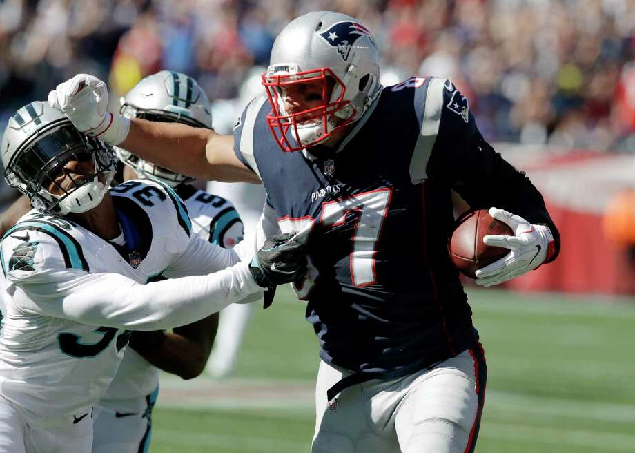 New England Patriots tight end Rob Gronkowski (87) tries to shove away Carolina Panthers defensive back Demetrious Cox (36) after catching a pass during the first half of an NFL football game, Sunday, Oct. 1, 2017, in Foxborough, Mass. (AP Photo/Charles Krupa) ORG XMIT: FBO122 Photo: Charles Krupa / Copyright 2017 The Associated Press. All rights reserved.