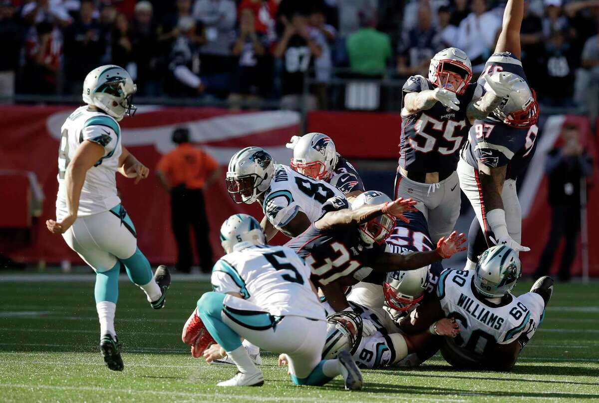 Carolina Panthers kicker Graham Gano, left, kicks the game-winning field goal as Michael Palardy (5) holds at the end of an NFL football game against the New England Patriots, Sunday, Oct. 1, 2017, in Foxborough, Mass. The Panthers won 33-30. (AP Photo/Charles Krupa) ORG XMIT: FBO136