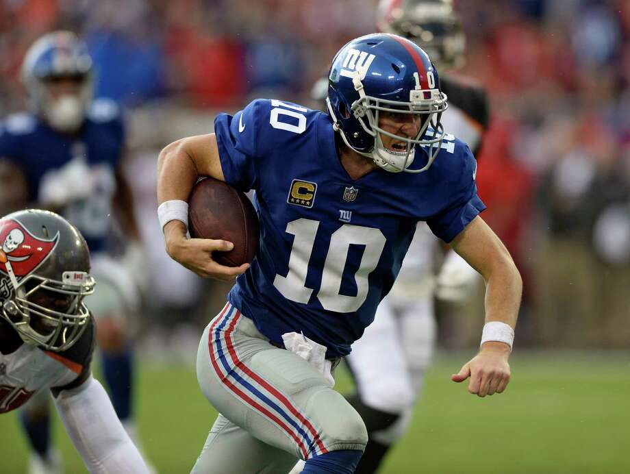 New York Giants quarterback Eli Manning (10) scores on a 14-yard touchdown run against the Tampa Bay Buccaneers during the second quarter of an NFL football game Sunday, Oct. 1, 2017, in Tampa, Fla. (AP Photo/Jason Behnken) ORG XMIT: TPS112 Photo: Jason Behnken / FR171457 AP