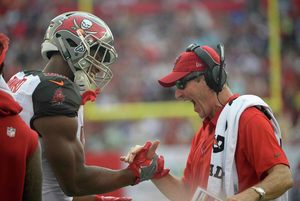 Tampa Bay Buccaneers head coach Dirk Koetter, right, celebrates with tight end O.J. Howard (80) after Howard coaught a 58-yard touchdown pass during the first quarter of an NFL football game against the New York Giants Sunday, Oct. 1, 2017, in Tampa, Fla. (AP Photo/Phelan Ebenhack) ORG XMIT: TPS106