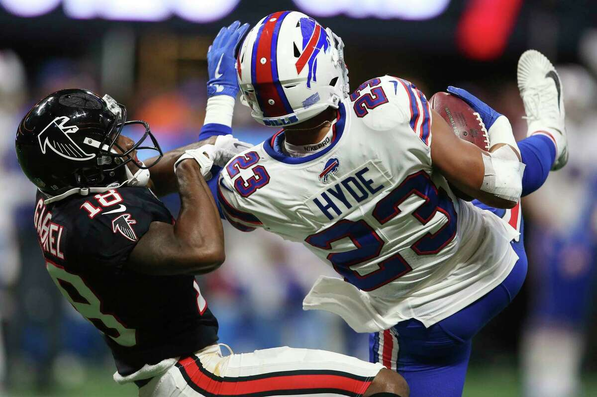Buffalo Bills strong safety Micah Hyde (23) intercepts a pass intended for Atlanta Falcons wide receiver Taylor Gabriel (18) during the second half of an NFL football game, Sunday, Oct. 1, 2017, in Atlanta. (AP Photo/John Bazemore) ORG XMIT: GAMS128