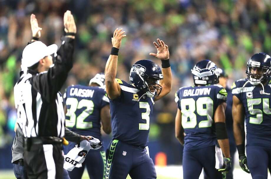 "Russell Wilson ""in his bag"" For the second straight game, Russell Wilson came alive in the second half. After throwing an interception in the first half and taking a sack for a safety, Wilson threw touchdowns in the second half and ran for another, in addition to finding Doug Baldwin for a two-point conversion. He finished the night 21 of 26 passing for 295 yards, two TDs and two INTs. That's a passer rating of 107.5. He also ran four times for 38 yards and a 23-yard score. This performance comes after he threw for a career-high 373 yards at the Titans last week. ""He was in his bag today,"" Richard Sherman said.  Photo: Grant Hindsley/SeattlePI"