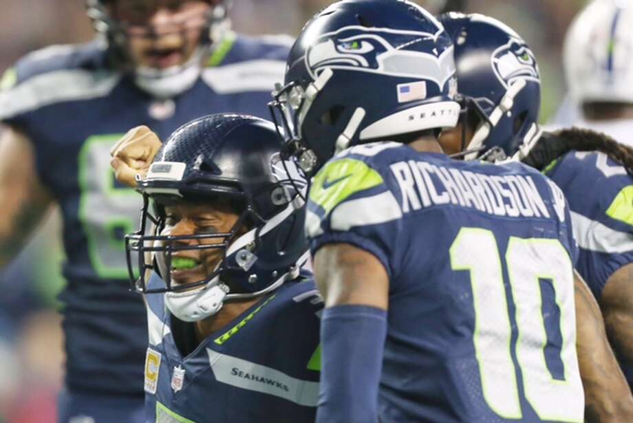 Seahawks quarterback Russell Wilson celebrates after scoring a touchdown in the third quarter of Seattle's game versus the Indianapolis Colts at CenturyLink Field on Sunday, Oct. 1, 2017. Photo: Grant Hindsley/SeattlePI