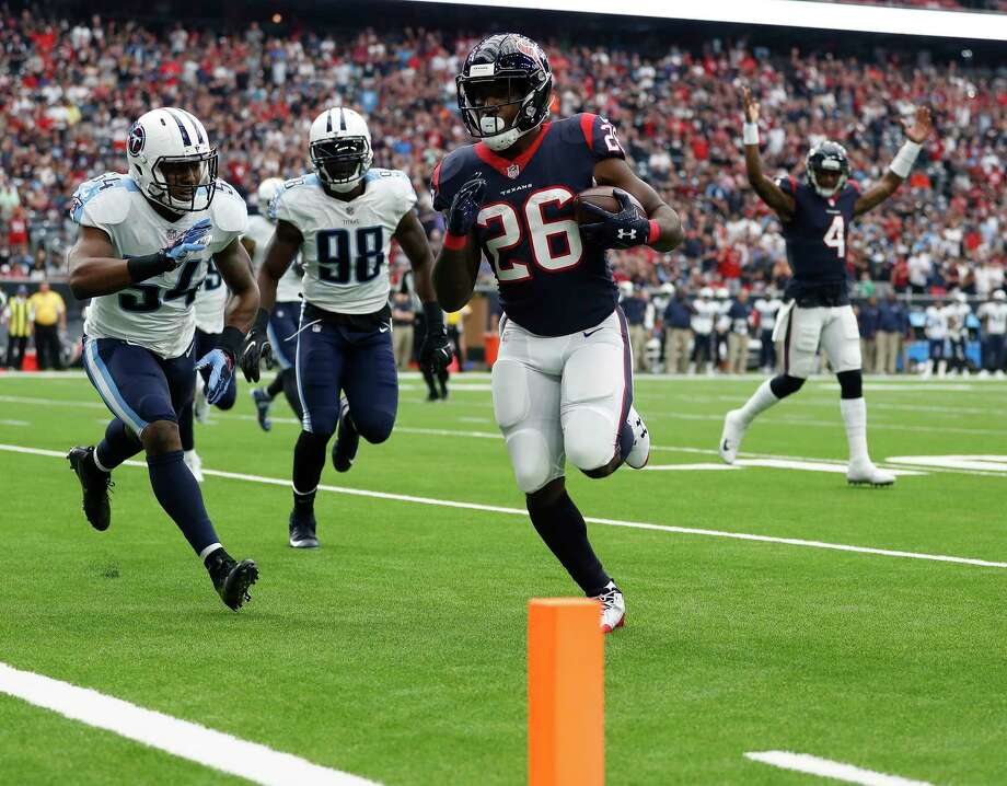 Texans running back Lamar Miller (26) is headed to the end zone after catching a pass from quarterback Deshaun Watson (4) during the first quarter Sunday. Photo: Karen Warren, Staff / @ 2017 Houston Chronicle