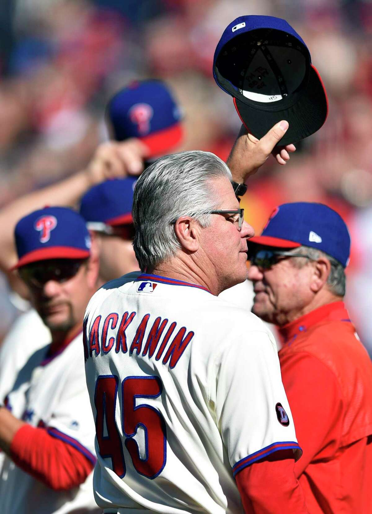 Philadelphia Phillies manager Pete Mackanin tips his cap to the crowd prior to a baseballgame against the New York Mets, Sunday, Oct. 1, 2017, in Philadelphia. (AP Photo/Derik Hamilton) ORG XMIT: PXS101