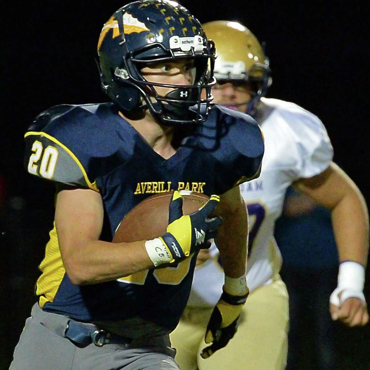 Averill Park's #20 Dom Law runs the ball during Friday night's game against Amsterdam Sept. 29, 2017 in Averill Park, NY. (John Carl D'Annibale / Times Union)