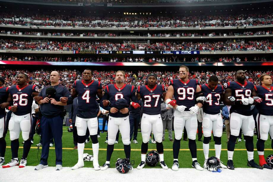 Texans players lock arms as they stand for the national anthem before Sunday's game against the Tennessee Titans at NRG Stadium. The Texans stood as a team during the anthem with some players locking arms. Photo: Brett Coomer, Staff / © 2017 Houston Chronicle
