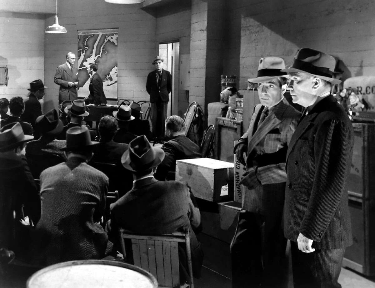 Hunphrey Bogart and William Demarest crash a meeting of Nazis led by Conrad Veidt (background) in