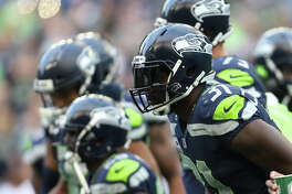 Seahawks safety Kam Chancellor runs to the bench before playing the Indianapolis Colts at CenturyLink Field on Saturday, Oct. 1, 2017.
